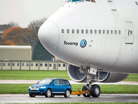 Car pulling a plane