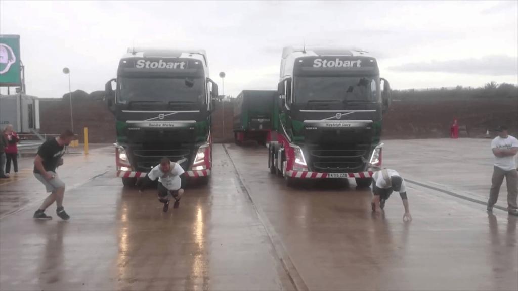 Men pulling trucks
