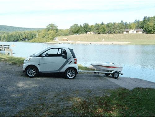 Smart Car pulling tiny boat-min