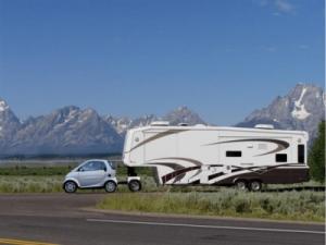 Smart Car towing huge caravan-min